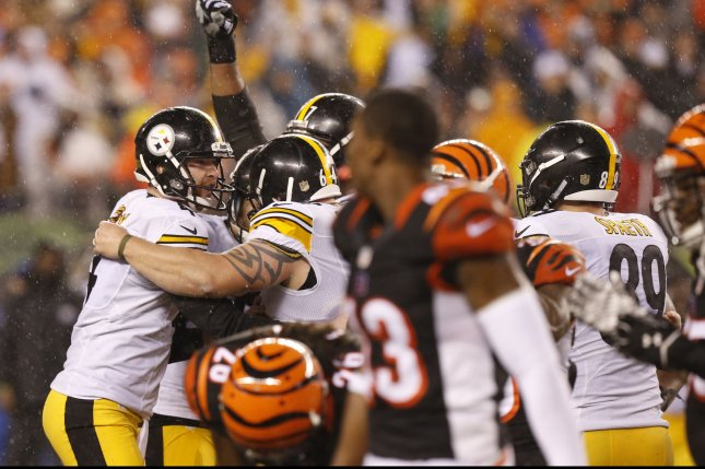 The Pittsburgh Steelers team celebrate with kicker Chris Boswell (9) after he kicked the game winning field goal to defeat the Cincinnati Bengals 18-16 in the second half of play in their NFL Wild Card Round game at Paul Brown Stadium in Cincinnati, Ohio, January 9, 2016. Photo by John Sommers II/UPI