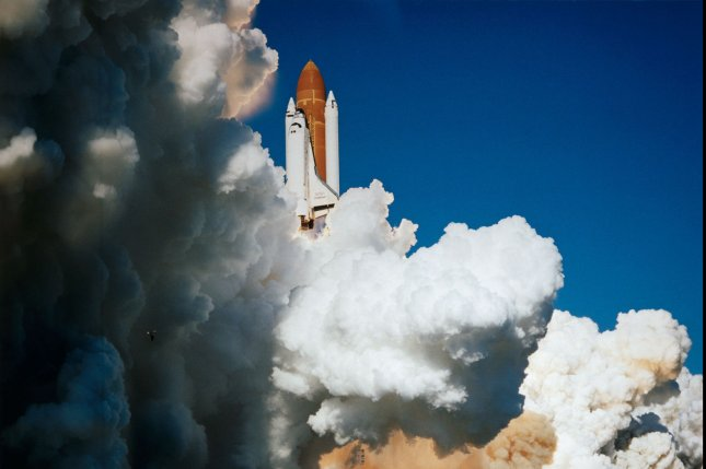 The Space Shuttle Challenger lifts off from Launch Complex 39, Pad B, at Kennedy Space Center, at 11:38 a.m. on January 28, 1986. At 11:39 a.m., the shuttle and its seven-member crew were lost when a ruptured O-ring in the right solid rocket booster caused an explosion 73 seconds after launch. UPI File Photo