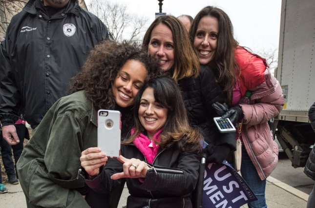 Alicia Keys takes a selfie at the Women's March on Washington on January 21. The singer appeared on Tuesday's episode of The Tonight Show starring Jimmy Fallon. File Photo by Ken Cedeno/UPI