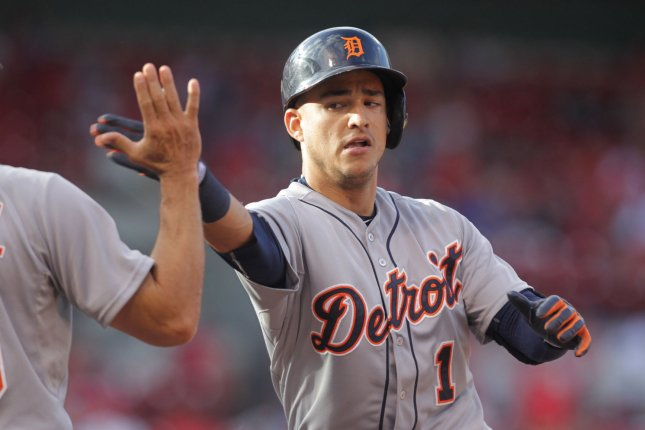 Detroit Tigers Jose Iglesias slaps hands after a base hit. File photo by Bill Greenblatt/UPI