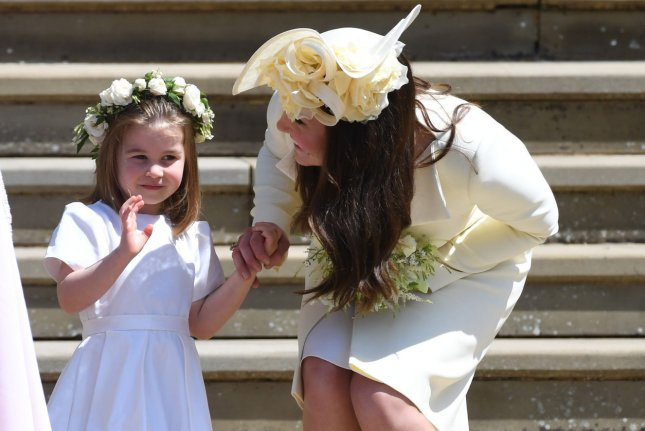 Princess Charlotte and her mother, Katherine Middleton, duchess of Cambridge, attend the wedding of Prince Harry and Meghan Markle May 19 at St. George's Chapel in Windsor Castle. Charlotte turns 4 Thursday. File Photo by Neil Hall/UPI