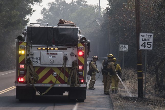 California Gov. Gavin Newsom and members of the state legislature announced plans Thursday to designate $536 million to bolster the state's efforts to combat wildfires. File Photo by Terry Schmitt/UPI