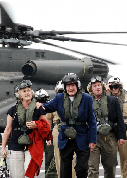Former U.S. President George H.W. Bush and his daughter, Doro Bush Koch, walk across the flight deck of the aircraft carrier USS George H.W. Bush (CVN 77) in the Atlantic Ocean on May 26, 2009. Bush and his daughter are aboard to observe flight operations during the ship's underway period. (UPI Photo/Dominique J. Moore/U.S. Navy)