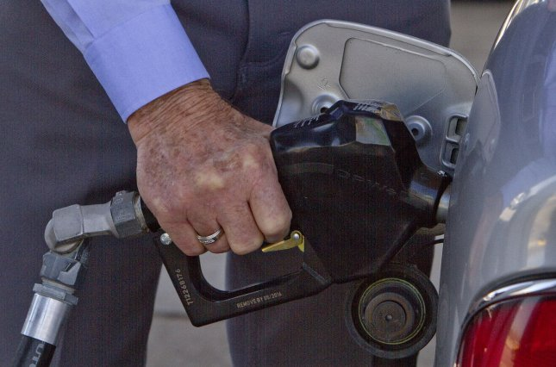 A motorist pumps gas in Denver on April 15, 2011. UPI/Gary C. Caskey