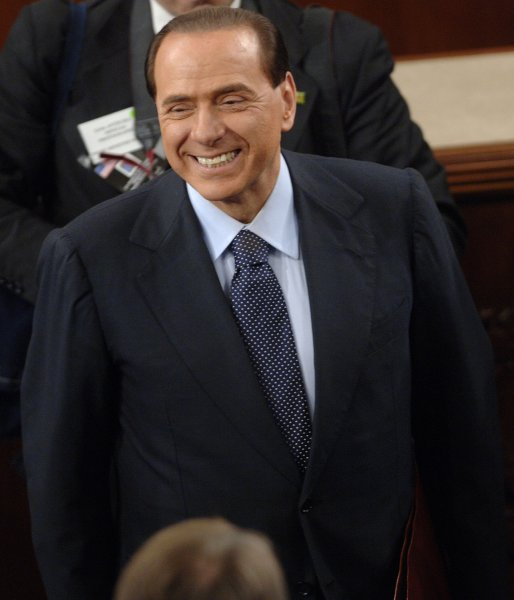 Italian Prime Minister Silvio Berlusconi arrives to address a Joint Session of Congress on Capitol Hill in Washington on March 1, 2006. (UPI Photo/Kevin Dietsch)