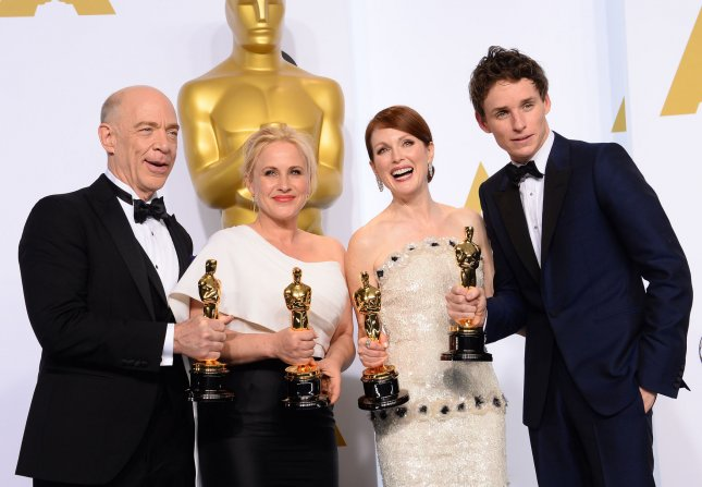 Best Supporting actor J.K. Simmons, Best Supporting actress Patricia Arquette, Best Actress Julianne Moore, and Best Actor Eddie Redmayne pose backstage with their Oscars during the 87th Academy Awards at the Hollywood & Highland Center in Los Angeles on February 22, 2015. Photo by Jim Ruymen/UPI