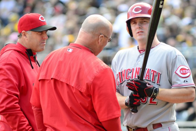 Cincinnati Reds manager Bryan Price (38) checks in on Cincinnati Reds right fielder Jay Bruce (32). Photo by Archie Carpenter/UPI