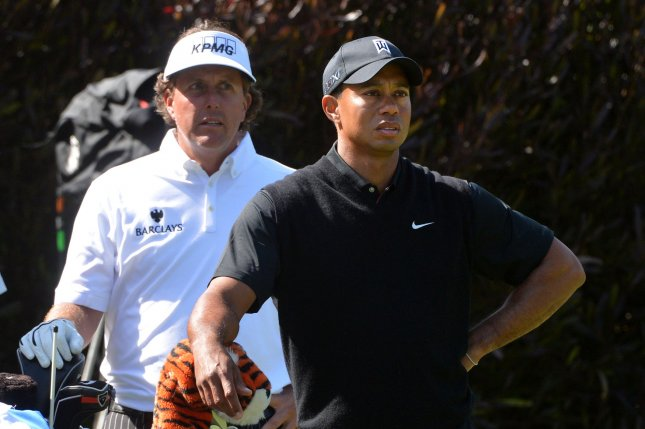 Tiger Woods and Phil Mickelson wait to hit on the 12th tee box of the 112th U.S. Open at the Olympic Club in San Francisco, California on June 15, 2012. File photo Kevin Dietsch/UPI