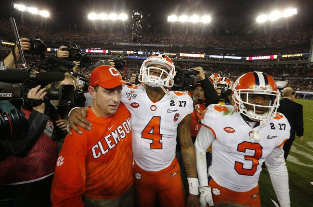 Head coach Dabo Swinney celebrates with quarterback Deshaun Watso of the Clemson Tigers after defeating the Alabama Crimson Tide at the 2017 College Football Playoff National Championship in Tampa on Monday. Photo by Mark Wallheiser/UPI
