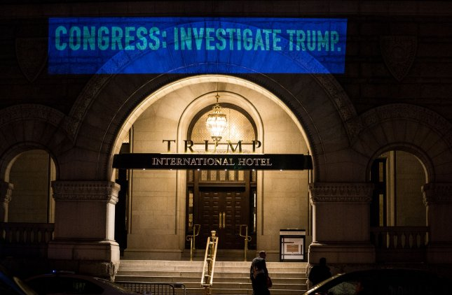 UltraViolet, a women's advocacy group, projects a message stating Congress: Investigate Trump onto the side of the Trump International Hotel on January 30, 2018.  A federal judge ruled Tuesday that a lawsuit accusing President Donald Trump of violating the Constitution by receiving payments from foreign governments through the hotel could proceed. File Photo by Erin Schaff/UPI