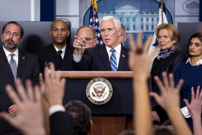 Vice President Mike Pence briefs on the coronavirus alongside his task force, at the White House on Tuesday. Photo by Kevin Dietsch/UPI