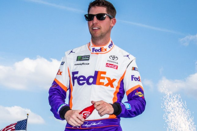 Denny Hamlin held off Cup Series leader Kevin Harvick and led a race-high 57 laps to win Thursday at Kansas Speedway Thursday in Kansas City, Kan. File Photo by Edwin Locke/UPI