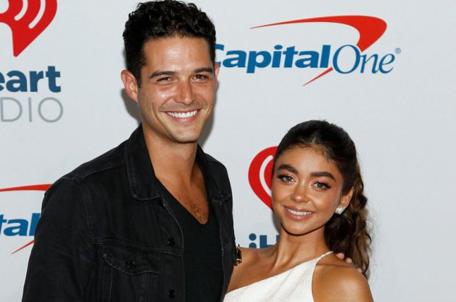 The coronavirus pandemic sidelined Wells Adams' (L) and Sarah Hyland's wedding plans for Saturday. File Photo by James Atoa/UPI