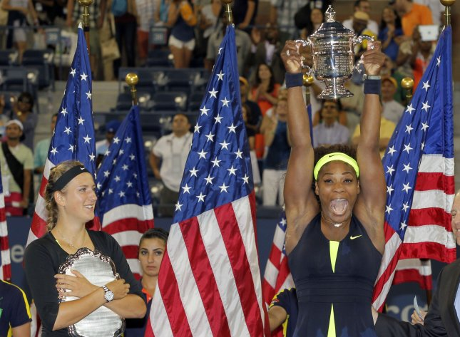 Victoria Azarenka (L) and Serena Williams, show their trophies after Williams won the U.S. Open final over Azarenka last September. Azarenka on Saturday won the Australian Open and keeps the world No. 1 ranking but Williams has pulled into a very close second. UPI/John Angelillo