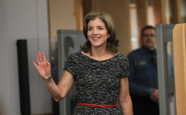 Caroline Kennedy waves to the crowd as she takes the stage to talk about her new book, Poems to Learn by Heart, at the St. Louis County Library in Frontenac, Mo., April 3, 2013. UPI/Bill Greenblatt