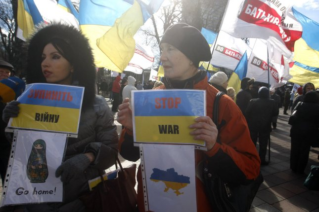Ukrainian rally for peace outside the parliament building in Kiev on March 17, 2014 a after the referendum on independence in Crimea. UPI/Ivan Vakolenko