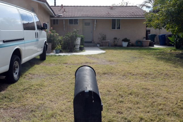 The former home of Syed Rizwan Farook, who with his wife killed 14 people in a mass shooting in California on Dec. 2 is pictured in Riverside, Calif., on December 6. FBI agents raided and searched the Riverside home of Enrique Marquez, a former neighbor and childhood friend of Farook. Marquez is believed to have purchased two of the guns used in the massacre. Photo by Jim Ruymen/UPI