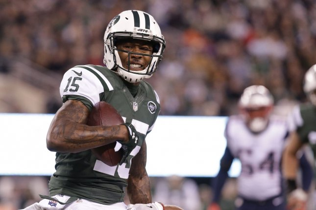 New York Jets Brandon Marshall carries the football in the first half against the New England Patriots in week 12 of the NFL at MetLife Stadium in East Rutherford, New Jersey on November 27, 2016. The Patriots defeated the Jets 22-17. Photo by John Angelillo/UPI