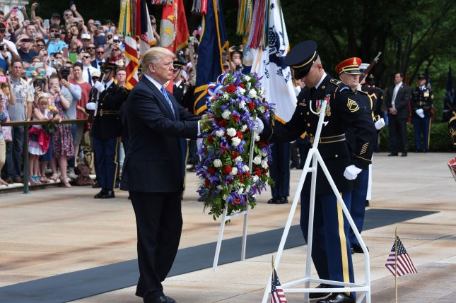 President Donald Trump participates in a wreath-laying ceremony at the Tomb of the Unknown Soldier at Arlington National Cemetery on Memorial Day in Arlington, Va. Photo by Olivier Douliery/UPI