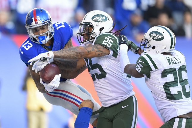 New York Giants wide receiver Odell Beckham (13) drops a pass as New York Jets cornerback Darrin Walls (26) and New York Jets strong safety Calvin Pryor (25) defend. Pryor was traded to the Cleveland Browns Thursday in exchange for Demario Davis. File photo by Rich Kane/UPI
