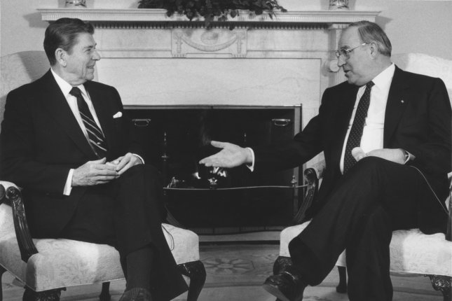 German Chancellor Helmut Kohl (R), meets with U.S. President Ronald Reagan in the Oval Office on March 5, 1985. Kohl died Friday at 87. File Photo by Don Rypka/UPI