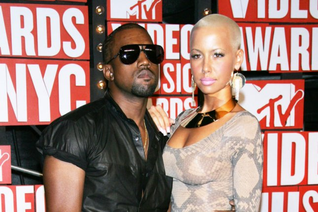 Amber Rose (R) and Kanye West attend the MTV Video Music Awards on September 13, 2009. The television personality discussed her breakup with West on Tuesday's episode of Everyday Struggle. File Photo by Laura Cavanaugh/UPI