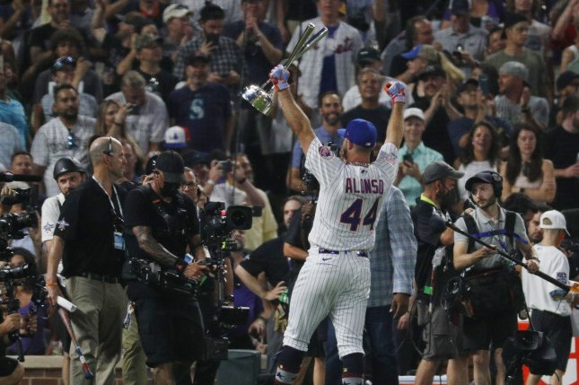 New York Mets slugger Pete Alonso holds the trophy after winning the 2021 MLB Home Run Derby on Monday at Coors Field in Denver. Photo by Bob Strong/UPI