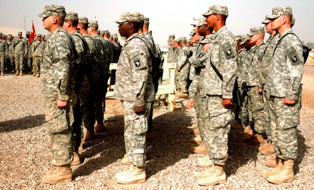 Soldiers of the Service Battery, 1st Battalion, 320th Field Artillery Regiment stand in formation during a ceremony at Camp Liberty, Iraq in this undated photo. (UPI Photo/HO)