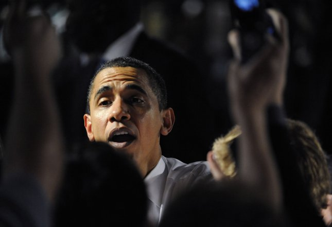 U.S. President Barack Obama shakes hands with audience members following a town hall meeting in Costa Mesa, California on March 18, 2009. (UPI Photo/Phil McCarten)