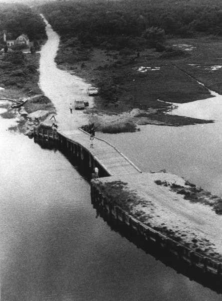 Aerial view of the Chappaquiddick Bridge, site of the Chappaquiddick incident. The Chappaquiddick incident refers to the circumstances surrounding the 1969 death of Mary Jo Kopechne, a former staff member in Senator Robert F. Kennedy's 1968 presidential campaign. U.S. Senator Edward M. Kennedy of Massachusetts was driving a car with Kopechne as his passenger when the Senator drove off Dike Bridge into the channel between Chappaquiddick Island and Martha's Vineyard. The Senator swam to safety, but Kopechne died in the car. Kennedy pled guilty to leaving the scene of an accident and received a suspended sentence of two months in jail. The incident became a national scandal and may have affected the Senator's decision not to run for President in 1972. Ted Kennedy attended a party on Chappaquiddick Island, adjoining Martha's Vineyard. The party was a reunion for campaign workers who had served in his brother Robert's 1968 presidential campaign. Kennedy drove away with party guest Mary Jo Kopechne as a passenger in his mother's 1967 Oldsmobile Delmont 88. According to Kennedy, he made a wrong turn onto an unlit dirt road that led to Dike Bridge (also spelled Dyke Bridge); a wooden bridge angled obliquely to the road with no guardrail, and drove over its side. The car plunged into tide-swept Poucha Pond (at that location a channel) and came to rest upside down underwater. Kennedy was able to swim free of the vehicle, but Kopechne was not. Kennedy claims he tried to swim down to reach her several times, then rested on the bank for several minutes before returning on foot to the Lawrence Cottage, where the party attended by Kopechne and other Boiler Room Girls had occurred. One of the Boiler Room Girls is now big-time New York literary agent Esther Newberg, who was Mary Jo's roommate for the weekend. Like everyone involved in the incident, Esther remains close-mouthed about what occurred. Joseph Gargan (Kennedy's cousin) and party co-host Paul Markham then returned to the p