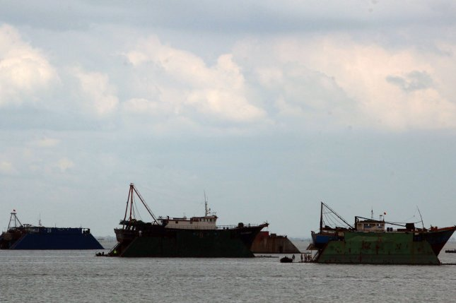 Chinese and Vietnamese fishing boats lobby for territory in the South China Sea. New research suggests climate change will encourage the flow of natural resource wealth from poorer to richer countries. File photo by Stephen Shaver/UPI