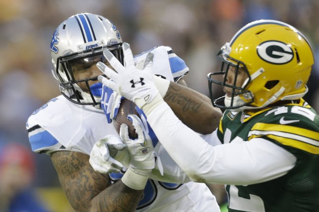 Detroit Lions' Eric Ebron, left, and Green Bay Packers' Morgan Burnett. UPI/Jeffrey Phelps