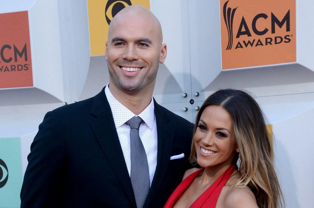 Jana Kramer (R), pictured with Mike Caussin, discussed her fertility struggles in a new interview. File Photo by Jim Ruymen/UPI
