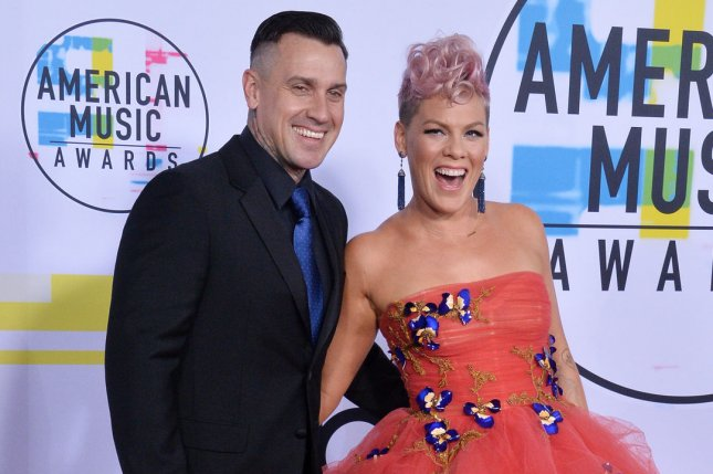 Carey Hart (L) and Pink celebrated their 13th wedding anniversary Tuesday. File Photo by Jim Ruymen/UPI