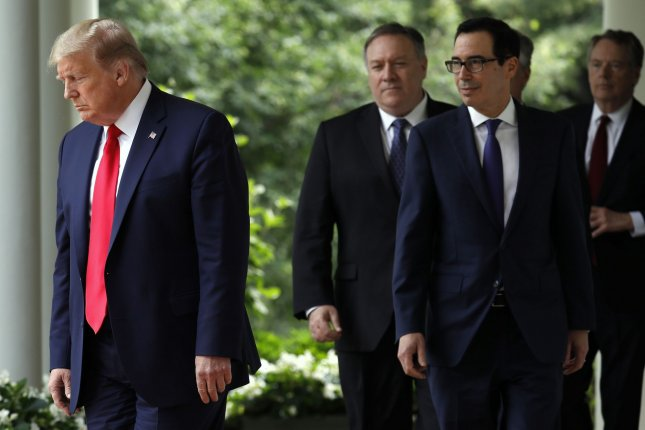 President Donald Trump walks to the Rose Garden at the White House on May 29 to announce sanctions against China for policies related to Hong Kong. The administration announced sanctions for Hong Kong officials on Friday. File Photo by Yuri Gripas/UPI
