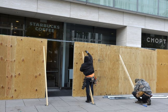 Workers board up businesses near the White House, Saturday, October 31, 2020, Washington, DC. Precautions are being made in case of violence on or after Election Day, Tuesday, November 3. Photo by Mike Theiler/UPI
