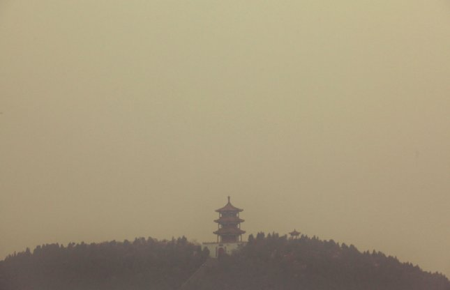 Heavy pollution blankets a hill-top temple and Denfeng City, Henan Province November 14, 2011. According to the World Bank, China has 16 of the world's 20 most polluted cities, with Henan (China's second most populous province) being one of the country's most polluted. Estimates suggest that close to 300,000 people die prematurely from respiratory diseases. UPI/Stephen Shaver