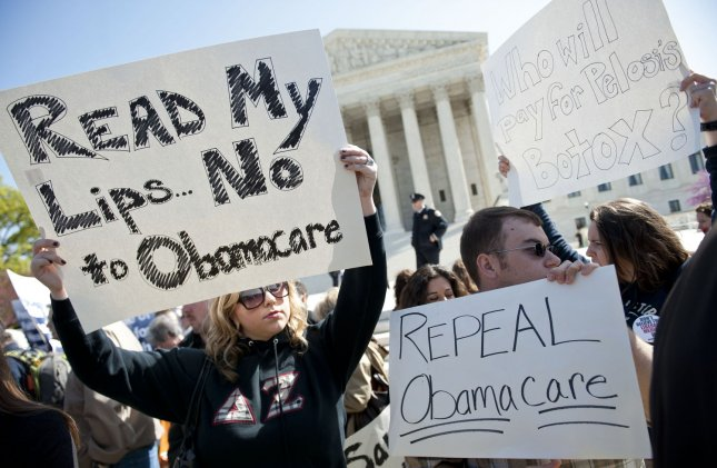 Protesters gather in front of the U.S. Supreme Court as the court begins hearing arguments on the constitutionality of the Patient Protection and Affordable Care Act in Washington, March 26, 2012. UPI/Kevin Dietsch