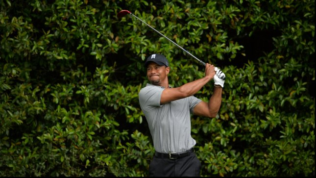 Tiger Woods watches his drive off of the 5th tee box during the first round of the Masters at Augusta National on April 11, 2013 in Augusta, Georgia. UPI/Kevin Dietsch