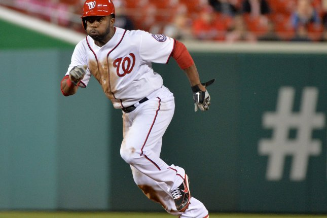 Washington Nationals Denard Span leaves second as he steals third against the Cincinnati Reds at Nationals Park on April 25, 2013 in Washington, D.C. UPI/Kevin Dietsch