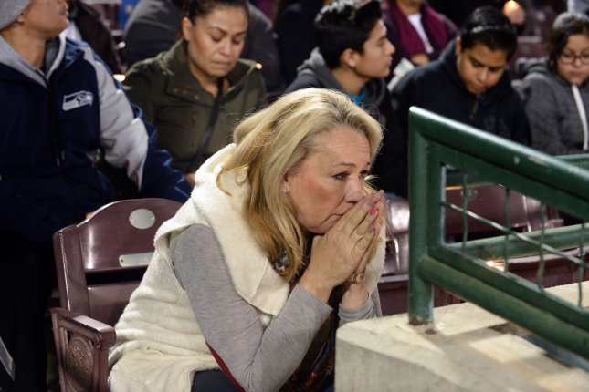 Thousands attend a candlelight vigil honoring the 14 people killed and 21 injured in Wednesday's mass shooting at the San Manuel Stadium in San Bernardino, Calif., on Thursday. Photo by Jim Ruymen/UPI