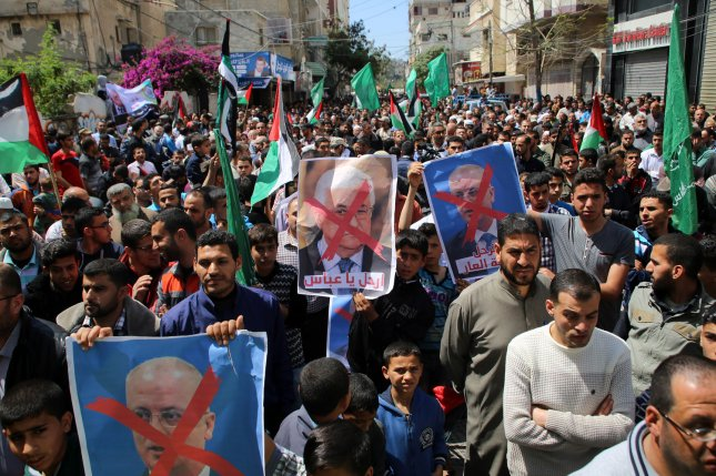 Supporters of the Palestinian Hamas movement hold crossed-out portraits of Palestinian Prime Minister Rami Hamdallah during a protest against the Israeli blockade of the Gaza Strip on April 14. Photo by Ibrahim Khatib/UPI