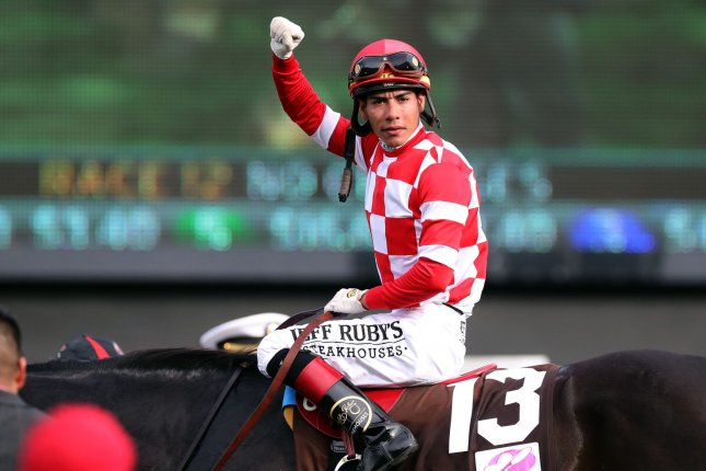 Jockey Jose Ortiz riding Serengeti Empress celebrates after winning the 145th Kentucky Oaks at Churchill Downs in Louisville on Friday. Photo by John Sommers II/UPI
