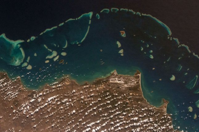 Researchers say they could slow the Great Barrier Reef's decline by about 20 years, but that climate change poses a significant threat to the world's largest living structure. File Photo by NASA/UPI
