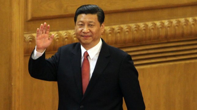 China's newly elected President Xi Jinping leads Politburo Standing Committee members (not pictured) Zhang Gaoli, Liu Yunshan, Zhang Dejiang, Li Keqiang, Yu Zhengsheng, and Wang Qishan into a meeting with both foreign and domestic press at the end of the 18th Communist Party Congress (CPC) in Beijing on November 15, 2012. Xi Jinping has been confirmed as the man to lead China for the next decade, and says the ruling Communist Party faces severe challenges. UPI/Stephen Shaver
