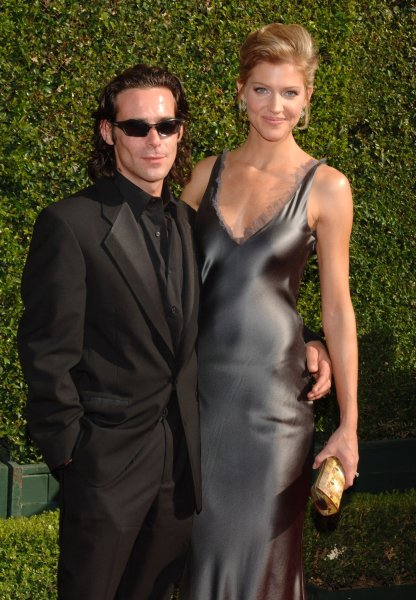 Canadian model and actress Tricia Helfer, star of the television series Battlestar Galactica and actor James Callis arrive for the 2005 Primetime Creative Arts Emmy Awards in Los Angeles September 11, 2005. Chalke is a presenter at the awards show which honors the technical aspects of television shows and is held (UPI Photo/Jim Ruymen)