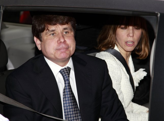 Former Illinois Gov. Rod Blagojevich, leaves the federal court with his wife Patricia, (R) after hearing the verdict in his corruption trial on June 27, 2011 in Chicago. A federal jury found Blagojevich guilty on 17 of 20 charges, including trying to peddle President Obama's vacant Senate seat. UPI/Kamil Krzaczynski