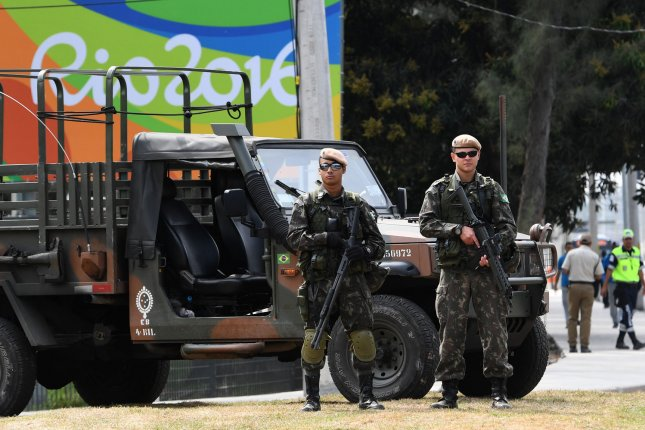 Brazilian soldiers have been deployed to Rio de Janeiro to provide additional security during the Summer Olympic Games. About 85,000 security forces, made up of the army, navy and police, will be deployed to the city's streets. On Monday, Rio de Janeiro said it would increase its force by more than 3,000 officers. Photo by Terry Schmitt/UPI