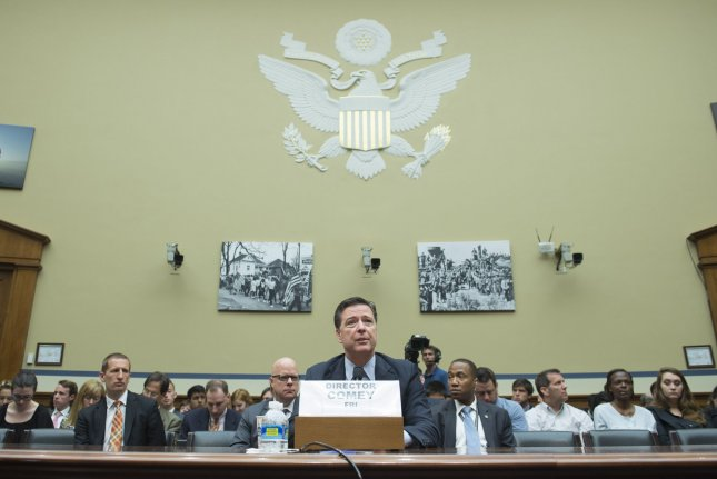 FBI Director James Comey testifies during a House Oversight and Government Reform Committee hearing on the investigation into Hillary Clinton's use of a private email server while she was Secretary of State on July 7. Monday, the FBI said it had not discussed the idea of trading favors with the State Department over the potential declassification of one of the emails. File Photo by Kevin Dietsch/UPI
