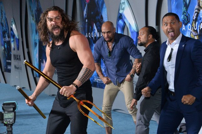 Cast member Jason Momoa joins haka dancers during the premiere of Aquaman in Los Angeles on December 12. The movie is No. 1 at the North American box office for a second weekend. Photo by Jim Ruymen/UPI